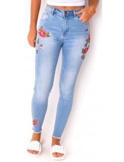 Jeans délavé à broderies