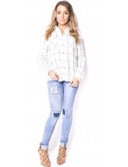 Jeans slim usé retroussé