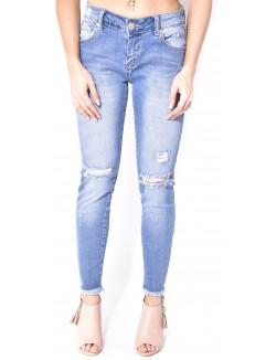 Jeans délavé déchiré